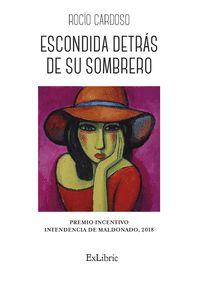 ESCONDIDA DETRS DE SU SOMBRERO